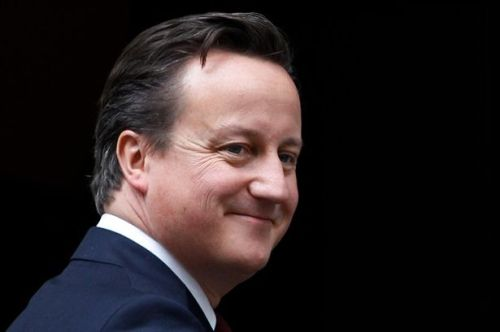Prime Minister David Cameron gestures outside 10 Downing Street.jpg