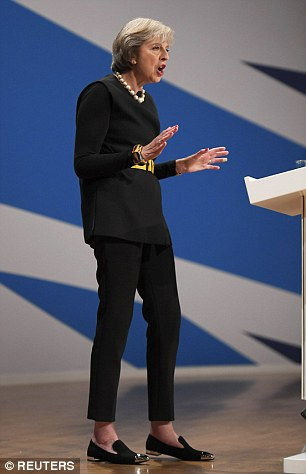 390707E800000578-0-Theresa_May_was_wearing_shoes_sporting_what_appeared_to_be_steel-m-4_1475448791203.jpg